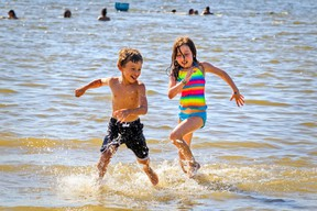 Megan Tannenbaum-Wise chases her brother Samuel through the water.