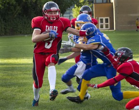 Aiden McMullen carries the ball for Lindsay Place during game against College de Montreal on Sept. 6.