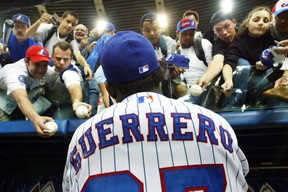 Montreal Expos right fielder Vladimir Guerrero signs autographs before the team's final home game of the season against the Atlanta Braves in Montreal Wednesday, Sept. 17, 2003. The Toronto Blue Jays will play a pair of pre-season games next spring at Montreal's Olympic Stadium. The Blue Jays will host the Mets on March 28-29 in the first Major League Baseball games to be played at the stadium in 10 years. THE CANADIAN PRESS/Ryan Remiorz
