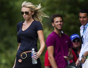 Paulina Gretzky follows her boyfriend Dustin Johnson during the final round of the 2013 RBC Canadian Open at Glen Abbey Golf Club in Oakville, Ont., Sunday, July 28, 2013. THE CANADIAN PRESS/Aaron Lynett