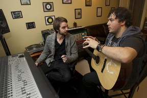 Producer Connor Seidel, pictured left, works with musician Patrick Di Meo in Baie-d'Urfé studio. (Marie-France Coallier/THE GAZETTE)