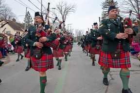 The Black Watch pipes and drums band marches down Main St. at the St-Patrick's Day parade in Hudson on March 16, 2013.