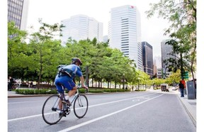A cyclist rolls down a bicycle lane in downtown Montreal on August 13, 2010. A high-profile ticketing blitz, a string of deadly accidents, and a growing dispute over the rules of the road suggests Montreal is experiencing some growing pains as city cycling becomes more common.