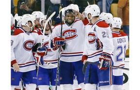Montreal Canadiens defenseman P.K. Subban, middle, and his teammates celebrate after defeating the Boston Bruins 3-1 in Game 7 of an NHL hockey second-round playoff series in Boston, Wednesday, May 14, 2014.