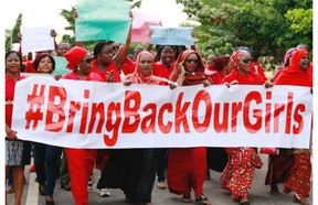 "Women attend a demonstration calling on the government to rescue the kidnapped schoolgirls of the Chibok secondary school, in Abuja, Nigeria, Tuesday, May 13, 2014. A Nigerian government official said ""all options are open"" in efforts to rescue almost 300 abducted schoolgirls from their captors as US reconnaissance aircraft started flying over this West African country in a search effort."