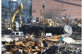 Excavator pulls a tanker from train derailment in downtown Lac-Mégantic on July 21, 2013.