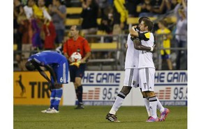 Columbus Crew players celebrates while a Montreal Impact player shows dejection at the end of a soccer match at Crew Stadium, Saturday, July 19, 2014, in Columbus, Ohio.