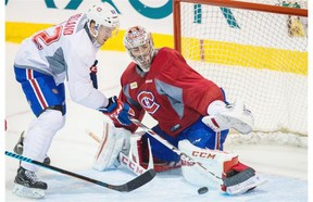 Canadiens goalie Carey Price makes a save against forward Patrick Holland during a team scrimmage at the Bell Sports Complex in Brossard on Sunday.