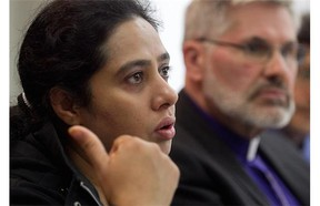 Tahira Malik, left, daughter of Khurshid Begum Awan, during a news conference in Montreal on Monday Sept. 22, 2014, with bishop Barry Clarke, to avoid deportation of her mother.