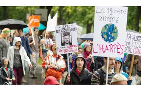 Thousands of people cram Lafontaine Park to take part in the People's Climate March in Montreal on Sunday. Similar marches are being held around the world ahead of the the climate summit in New York City held by UN Secretary-General Ban Ki-moon.