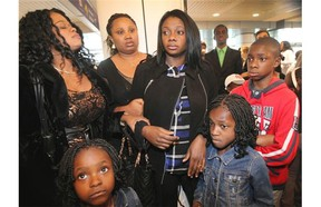 Winifred Agimelen, middle, and her three children were set to be deported to Nigeria. Friends and supporters gathered to support them at the Dorval airport on Sunday, few hours before their flight back to Nigeria.