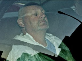 Shooting suspect Richard Henry Bain in the back of a police car as he arrives at the Montreal courthouse on Thursday, Sept. 6, 2012.