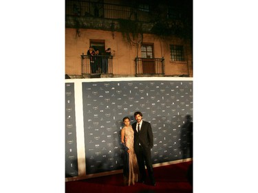 Guatemalan actress Karen Martinez and Spanish director Diego Quemada-Diez pose for photographers during their red carpet walk during the Fenix Iberoamerican Film awards at the Esperanza Iris Theater in Mexico City, Thursday Oct. 30, 2014.