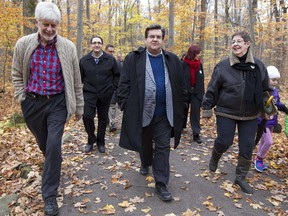 Montreal Mayor Denis Coderre (centre) meeting with the Green Coalition at Bois de Liesse Park, Saturday Oct. 25, 2014.