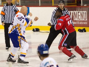 Brandon Christian of the Laval Prédateurs (left) and Samuel Duplain of Saint-Georges Cool FM square off to fight at the Colisée de Laval in a Ligue Nord Américaine de Hockey game on Oct. 12, 2014. Though fighting is still a feature of semi-pro games, the number of them are a lot less than what they were in previous years.