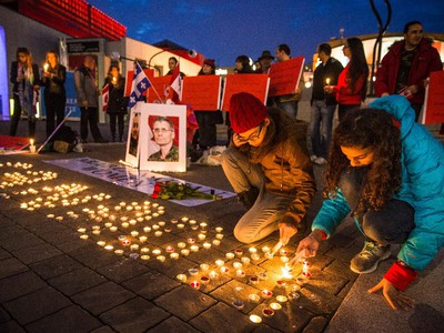 Girls light candles to spell out Canada during a vigil organized by Arab-Canadian women to honour slain soldiers Corporal Nathan Cirillo and Warrant Officer Patrice Vincent at Place des Arts in Montreal on Tuesday, Oct. 28, 2014.
