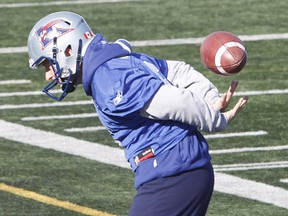 Alouettes kicker Sean Whyte plays with a football during practice in St-Léonard on Oct. 31, 2014, as the club prepared to face the Toronto Argonauts on Sunday, November 2, 2014.
