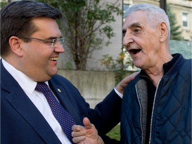 Sept. 25, 2014: After meeting with members of the media during a press conference about the city's homeless, Mayor Denis Coderre speaks with René Lallemand,a client of the Maison du Père homeless shelter.