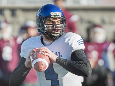 Montreal Carabins quarterback Gabriel Cousineau sets up a play against the McMaster Marauders during first half CIS Vanier Cup football action in Montreal Saturday, November 29, 2014.