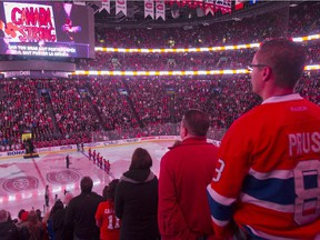 Canadiens fans listen to the national anthem before game against the New York Rangers at the Bell Centre on Oct. 25, 2014.