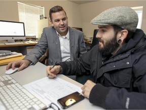 West Island Youth Action director general Benoit Langevin, left, meets with youth outreach worker Christophe Hotte at their office in St-Genevieve on Friday Nov. 21, 2014.
