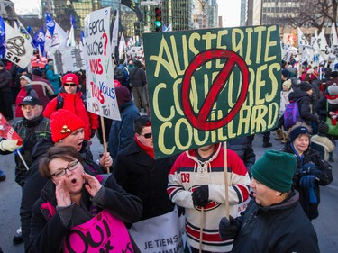 People take part in an anti-austerity protest in downtown Montreal on Saturday, November 29, 2014.