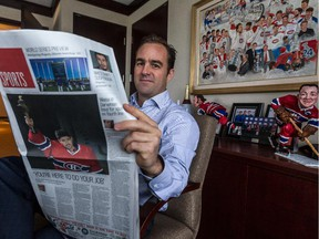 Canadiens owner, president and CEO Geoff Molson reads sports section of the redesigned Montreal Gazette in his office at the Bell Centre on Oct. 21, 2014.