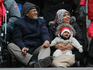 Kabir Chowdhury enjoyed the 64th edition of the Santa Claus parade on Ste. Catherine St. with his daughter Rafia and granddaughter Reyhan in Montreal Saturday, November 22, 2014.