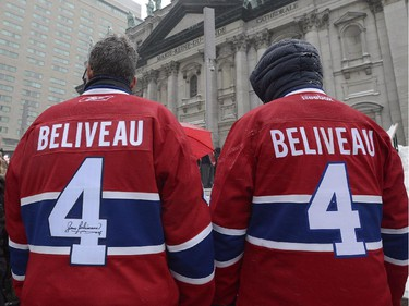 Fans wait outside Montreal Cathedral before the funeral for former Montreal Canadiens captain Jean Béliveau in Montreal, Wednesday, Dec.10, 2014.