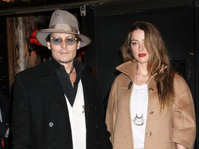 """Johnny Depp and Amber Heard seen here arriving at the Broadway opening night of """"Cabaret"""" at Studio 54 on April 24, 2014 in New York City."""