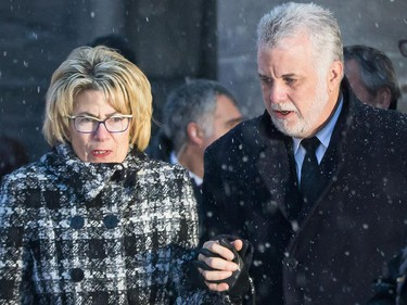 Quebec Premier Philippe Couillard, right, and wife Suzanne Pilote, left, leave the funeral for Montreal Canadiens hockey great Jean Béliveau at the Mary Queen of the World Cathedral in Montreal on Wednesday, December 10, 2014.