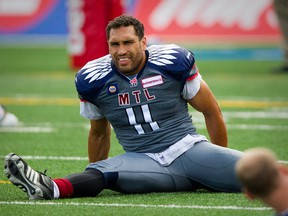 Alouettes linebacker Chip Cox stretches  during warmup before CFL game against the Hamilton Tiger-Cats at Molson Stadium on Sept. 7, 2014.