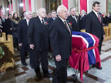 Pallbearers and former teammates (left to right) Dickie Moore, Jean-Guy Talbot, Phil Goyette, Yvan Cournoyer, Guy Lafleur and Serge Savard carry the casket of former Montreal Canadiens captain Jean Béiveau into his funeral service at Mary Queen of the World Cathedral in Montreal, Wednesday, Dec.10, 2014.