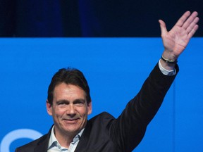 Pierre Karl Peladeau waves to supporters in Saint-Jerome, Que., Sunday, November 30, 2014 where he officially launched his bid to become leader of the Parti Quebecois.