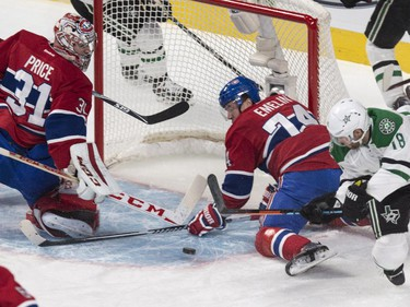Montreal Canadiens defenceman Alexei Emelin stops a shot by Dallas Stars' Patrick Eaves behind Canadiens goalie Carey Price during first period NHL hockey action Tuesday, January 27, 2015 in Montreal.