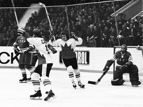 Paul Henderson (with helmet) and Bobby Clarke of Team Canada celebrate Henderson's series-winning goal in Game 8 of the 1972 Summit Series between Canada and the Soviet Union at the Luzhniki Ice Palace in Moscow, Soviet Union, on Sept. 28, 1972.