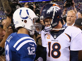 Andrew Luck of the Indianapolis Colts (left) and Peyton Manning of the Denver Broncos meet after game at Lucas Oil Stadium on Oct. 20, 2013 in Indianapolis.