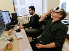 Félix Lajeunesse, right, and Paul Raphaël work on one of their virtual-reality projects at their studio in Old Montreal on Tuesday, Jan. 20, 2015.