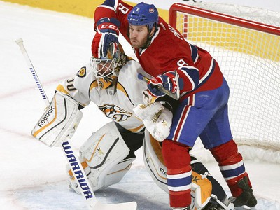 Montreal Canadiens Brandon Prust tries to avoid contact with Nashville Predators  goalie Carter Hutton during second period of National Hockey League game in Montreal Tuesday January 20, 2015.