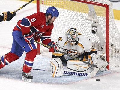 Montreal Canadiens Brandon Prust tries to control rebound in front of Nashville Predators goalie Carter Hutton during second period of National Hockey League game in Montreal Tuesday January 20, 2015.