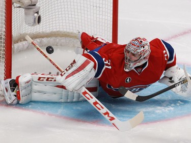 Carey Price of the Montreal Canadiens makes a save against Jamie Benn of the Dallas Stars in the second period of an NHL game at the Bell Centre in Montreal Tuesday, January 27, 2015.