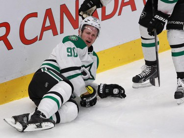 Jason Spezza of the Dallas Stars lies on the ice after being knocked into the boards by Alexei Emelin of the Montreal Canadiens  in the second period of an NHL game at the Bell Centre in Montreal Tuesday, January 27, 2015. Emelin received a five-minute penalty and a game misconduct.