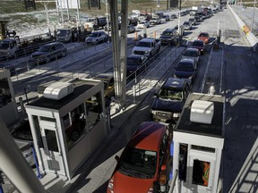 Traffic started to flow through the newly opened Highway 30 toll booth in Les Cedres on Dec. 15, 2012.