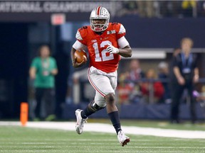 Ohio State quarterback Cardale Jones runs the ball against the Oregon Ducks during the College Football Playoff National Championship Game on Jan. 12, 2015 in Arlington, Texas.