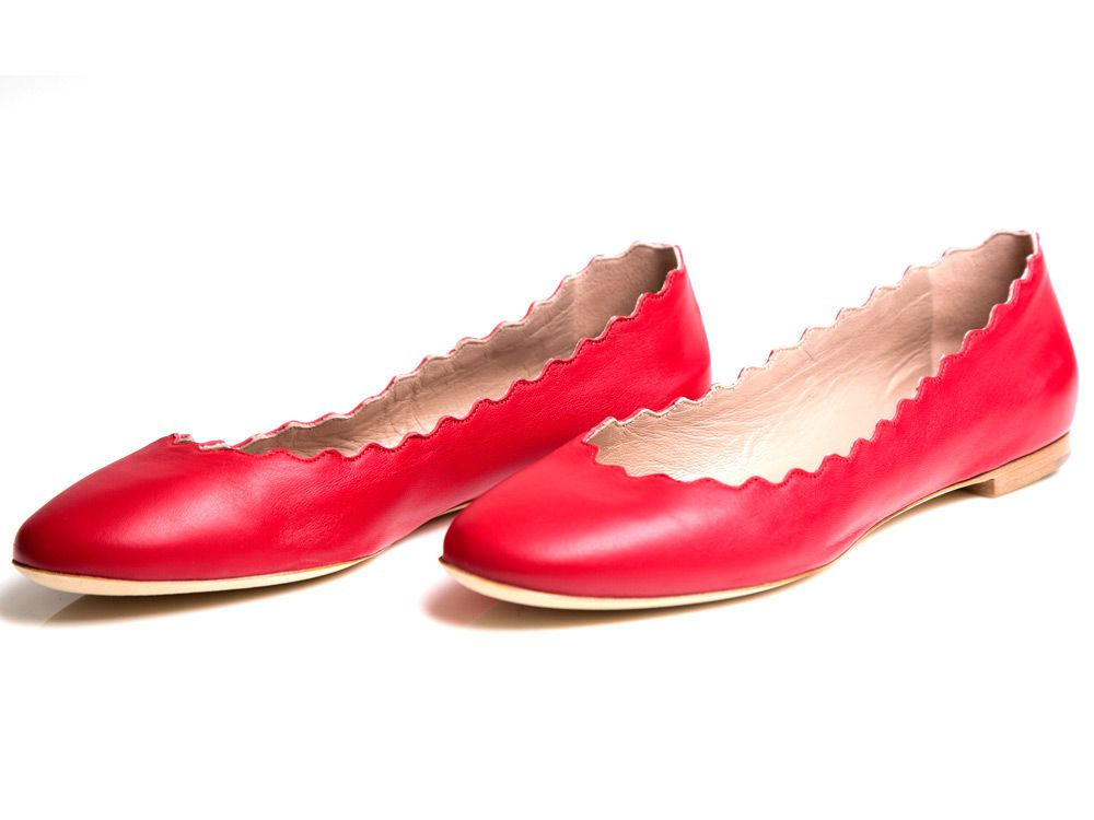 FLAT OUT Buttery soft red leather fl ats from Chloe are comfy and anything but basic thanks to fi nely scalloped edging. $515, available at Holt Renfrew, 1300 Sherbrooke St. W., holtrenfrew.com