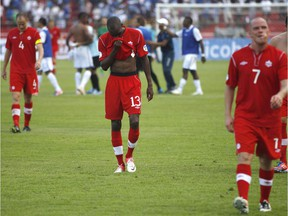 Canada's Atiba Hutchinson, centre, leaves the field after a game against Honduras during 2014 World Cup qualifying in San Pedro Sula, Honduras, on Oct. 16, 2012.