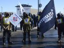 Canadian Pacific Railway workers walk the picket line while on strike at the Côte St-Luc railyard in Montreal on Monday, Feb. 16, 2015. The rail workers, represented by the Teamsters, walked off the job Sunday morning after contract talks failed to produce an agreement.   On Monday afternoon, federal Labour Minister Kellie Leitch said the strike is over, with both sides agreeing to resume discussions. News of the deal comes with the government poised to introduce back-to-work legislation and the Commons debating a speedy process to pass it.