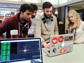 McGill students, from left, Deepanjan Roy, Shivan Kaul, Amiel Kollek and Clare Lyle at the university's student union building Feb. 19, 2015, in Montreal. They are helping organize a hackathon at McGill.