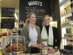 Owners Rebecca, left, and her sister Mandy Wolfe are all smiles as they stand behind the counter at Mandy's in Westmount.