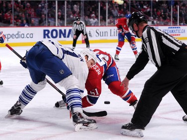 Olli Jokinen #11of the Toronto Maple Leafs and David Desharnais #51 of the Montreal Canadiens face-off during during an NHL game at the Bell Centre on Feb. 28, 2015 in Montreal, Quebec, Canada.